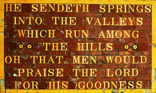 Inscription from Psalms displayed on the side of the Fulking pump house