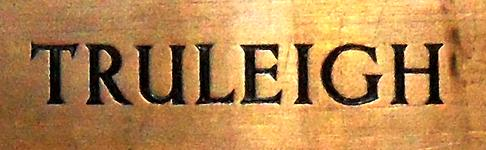 Close-up of part of a brass wall plaque in St. Andrew's, Edburton