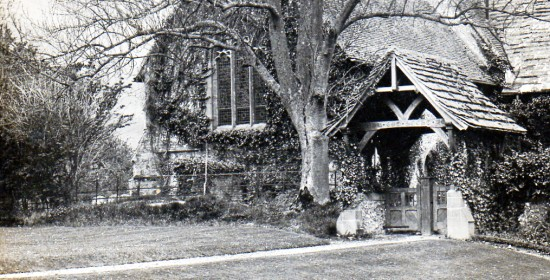 The lych gate that links the rectory garden to the churchyard