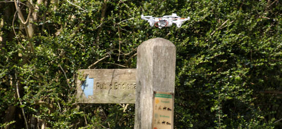 Drone hovers over bridleway sign