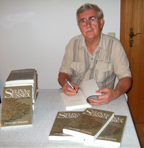 Selena of Sussex author Len Holder signing copies of his book